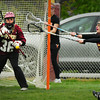 Newburyport: A shot on Newburyport goalie Carly Kouvaris goes wide as teammate Rebecca Blaustein (14) tries to block. Bryan Eaton/Staff Photo