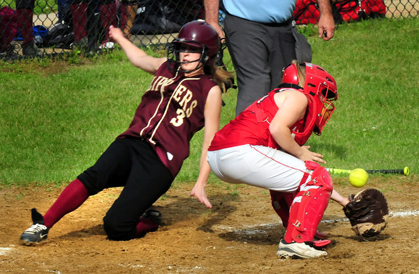 Newburyport: Clipper's Leah Tomasz makes it home as Amesbury catcher Cassandra Schultz gets the late throw. Bryan Eaton/Staff Photo