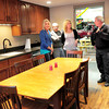 Salisbury: Nicole Oliveira, left, and her sister Kaylie, along with former fire chief Robert Cook, and deputy chief Steve LeSage, right, check out the new kitchen at the Salisbury Fire Department. The room was renovated in memory of their father Lt. Timothy Oliveira who died in the line of duty last July. Bryan Eaton/Staff Photo