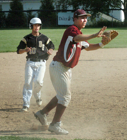 Newburyport: Newburyport third baseman Cam Roy holds the throw as Bishop Fenwick's Mike Cipriani makes the base. Bryan Eaton/Staff Photo