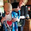 Merrimac: Tutor Kathy Terceiro helps Emma Jouneay with a kimono from Japan. Bryan Eaton/Staff Photo