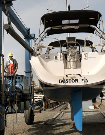 Newburyport: More boats can be seen in the Merrimack River every day as area boatyards are swinging in to high gear. Joe Jancewicz of the Windward Yacht Yard moves this Hunter 31 into position Monday afternoon and will lower it in in the morning when the tide is higher. Bryan Eaton/Staff Photo