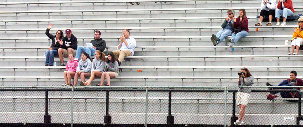 Newburyport: Newburyport High School girls lacrosse fans cheer on the team as they were introduced before the game with Manchester-Essex yesterday. The sky was overcast, but any showers that may have came were forecast to come in later at night. Bryan Eaton/Staff Photo