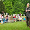 Amesbury: Arnold Lessard of Merrimac talks to Amesbury Elementary School students about what Memorial Day means to him before they set flags on the graves of veterans. The Newburyport native was a navigator on a bomber during World War II. Bryan Eaton/Staff Photo