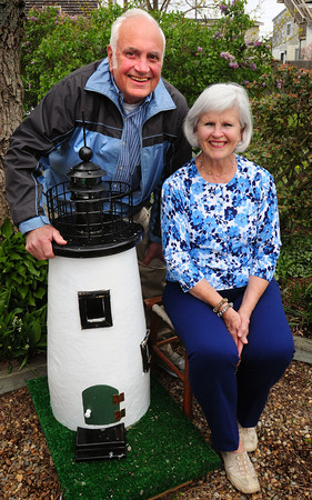 Newburyport: Long time active Plum Island residents Jim and Pat Frey are moving back to their native New Jersey. The Plum Island Taxpayers Association presented them with this mini lighthouse, a replica of Plum Island Light in which they helped renovate. Bryan Eaton/Staff Photo