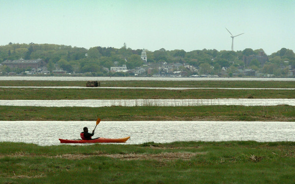 Salisbury: One of several kayakers paddle along the waters at Salisbury Beach State Reservation yesterday afternoon as the sky cleared. Except for a shower or two the Mother's Day weekend is forecast to be sunny. Bryan Eaton/Staff Photo
