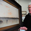 Newburyport: Skip Motes, with a painting of the Newburyport waterfront in the mid-1800's by artist Fitz Hugh Lane, as doing a presentation of the history of the waterfront at the Custom House Maritime Museum. Bryan Eaton/Staff Photo