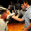 """Amesbury: Amesbury Middle School Principal Mike Curry gets a double pie in the face from students Troy Marden, center, 10, and Colin MacDonald, 11. The """"Pie a Teacher"""" was a fundraiser to raise money for various military organizations. Bryan Eaton/Staff Photo"""