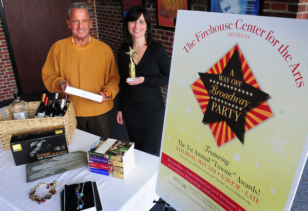 Newburyport: Louis Rubenfeld holds an Ipad with other items for auction, and Beth Falconer shows off the first Townie Award for the upcoming A Way Off Broadway Party to benefit the Firehouse Center for the Performing Arts. Bryan Eaton/Staff Photo