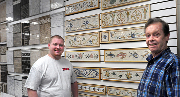 Newburyport: Chris Bates, left, and Art Bates of Tiles Gone Wild, missing is designer Lisa McCarthy. Bryan Eaton/Staff Photo