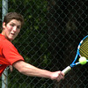 Newburyport: Amesbury's Grant Bellino in first singles action against Newburyport. Bryan Eaton/Staff Photo