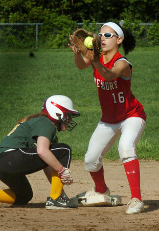 Amesbury: Amesbury's Amanda Schell makes the catch at second, but this North Reading player was called safe heading back to second. Bryan Eaton/Staff Photo