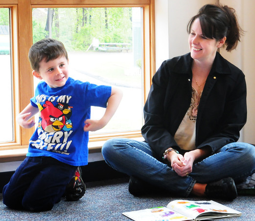 Byfield: Chase Kennedy, 4, of Georgetown, with mom, Kristina, imitates a chimpanzee as he learns the basics of sign lanauage at Children's Hour at the Newbury Public Library. Lindsey Aylward is a guest librarian teaching American Sign Lanquage to 3-5 year olds for the next three  Wednesdays at 11:00 am. Bryan Eaton/Staff Photo