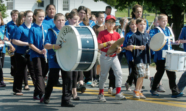 Salisbury: The Salisbury Elementary School Band march in the Memorial Day Parade along Route One on Monday. The procession concluded at the town common for a ceremony and speeches. Bryan Eaton/Staff Photo