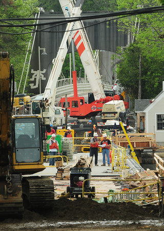 Amesbury: Workers can now easily access the new Hines Bridge in Amesbury as the spans have been completed. The heavily traveled bridge, along with the Chain Bridge, is scheduled to reopen in mid to late July. Bryan Eaton/Staff Photo
