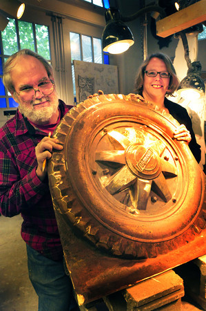 Newburyport: Sculptor Jeffrey Briggs and Annmary Connor, director of the Amesbury Council on Aging, show off a bronze piece of his work that will be incorporated into Amesbury's new Costello Transportation Center that will also house the council on aging. Bryan Eaton/Staff Photo