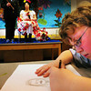 "Amesbury: Amesbury Middle School student Robbie McGrail, 11, sketches a print of ""Diego RIvera"" and ""Frida Kahlo"" played respectively by Chris Pelletier, 10, and Carol Bartlett from the school superintendent's office in Susan Olsen's art class on Thursday morning. Kahlo is a 20th century Mexican artist the students have been learning about whose work was mostly done in a surreal of theatrical mode. Bryan Eaton/Staff Photo"