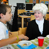 Salisbury: Jim Boschen, 9, left as Jackie Robinson and Eddie Tarmey, 10, as George Washington chat at a Biography Tea at Salisbury Elementary School on Monday. The students in Kim Peterson's fourth grade class researched people from the past and presented them to each other in the school library. Bryan Eaton/Staff Photo