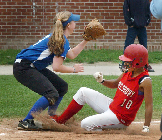 Amesbury: Amesbury's Alexis Boswell slides into third for a triple as her pop fly was dropped, as third baseman Callie O'Connor waits for the throw. Bryan Eaton/Staff Photo