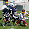 Newburyport: Newburyport's Drew Bourdeau fights for the ball with Triton's Lawrence Cuddy and Paul Dacy during their game at War Memorial stadium in Newburyport. Jim Vaiknoras/staff photo