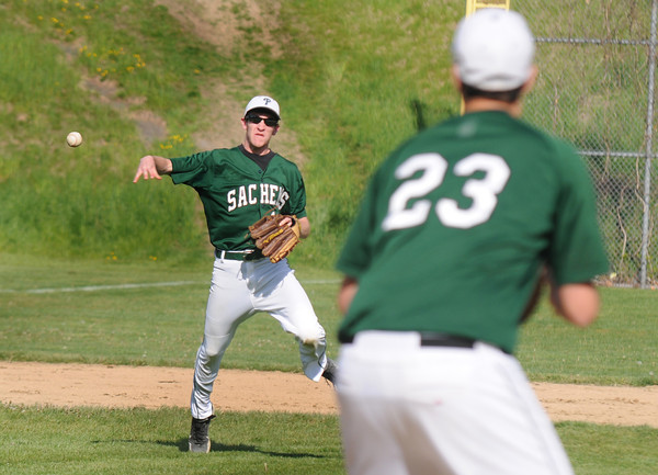 Newburyport: Pentucket's Coery McNamara throws out a Newburyport runner during their game at Pettingill Park in Newburyport Monday. Jim Vaiknoras/staff photo