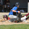 Newburyport: Georgetown catcher Mark Buckland tags out Newburyport's Mike Sweeney on a close play at the plate during their game Saturday at Pettengill Field in Newburyport. Jim Vaiknoras/staff photo