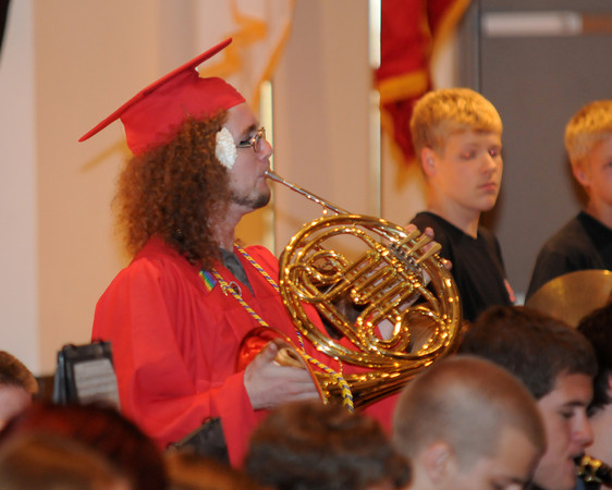 Amesbury: Graduating Senior Mike Felix play the french horn with the high school band at the Sing Out atAmesbury High school Friday. Jim Vaiknoras/staff photo