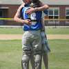 Georgetown: Veteran Paul Berkman hugs his son, Georgetown high catcher Mark Berkland, after he tossed out the first pitch at the championship game of the Bert Spofford Tournament between Georgetown and Triton Sunday in Georgetown. JIm Vaiknoras/staff photo