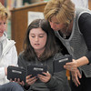 "Newburyport: Nock Middle School librarian Ellen Menesale helps Meagan Crawley and her mom Kelly find a page on their Nooks. The readers were donanted by the Newburyport Education Foundation and were being used for Discovering History book group meeting Thursday night. The group is discussing the book ""Mississippi Trail"" by Chris Crowe, a historical fiction book about what is now seen as a pivotal moment in the Civil rights movement that they just finished reading. JIm Vaiknoras/staff photo"