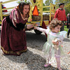 Newbury: Chloe Vercauter, 3,  turns away as she hand a flower to birthday girl Kimm Wilkinson at a surprize Renaissance themed<br /> party for her at the Newbury home of Stephen Faria and Deidre Girard Sunday. jim vaiknoras/staff photo