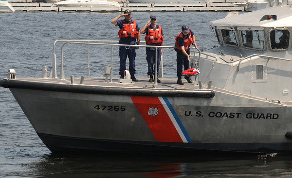 Newburyport: A wreath is tossed into the Merrimack River from a Coast Guard boat at annual Newburyport Memorial Day ceremony. Jim Vaiknoras/staff photo