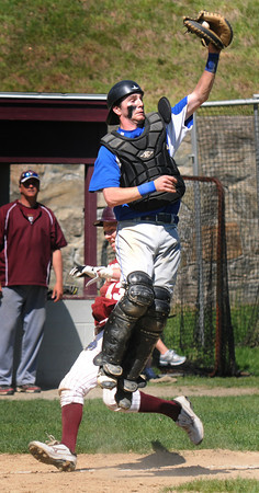 Newburyport: Georgetown catcher Mark Buckland goes up for a high trow as Newburyport's Connor Wile scores during their game Saturday at Pettengill Field in Newburyport. Jim Vaiknoras/staff photo