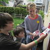 "Newburyport: Meghan Kinsey shows her sons Christian, 9, and Asher, 5, how to put flyers on door knobs promoting  ""Port Pride"" a group supporting approval of 2 school projects and a senior center. Jim Vaiknoras/staff photo"