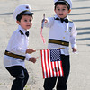 Seabrook: Aydan Almeida , 4, and his twin brother Adryan wave their flags as the annual Seabook Memorial Day Parade makes it's way down Walton Road Sunday morning. Jim Vaiknoras/staff photo