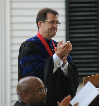 Byfield: First year Headmaster Dr Peter Quimby applauds the parents of the graduates at the 249th Governor's Academy commencement Sunday in Byfield. Jim Vaiknoras/staff photo
