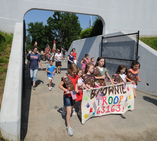 Amesbury: Brownie Troop 63163 makes it's way into Landry Stadium in Amesburyfor the annual Memorial Day ceremony. Jim vaiknoras/Staff photo