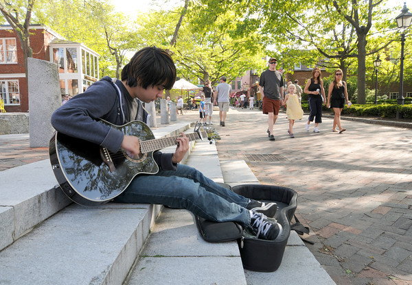 NEWBURYPORT: Alex Pascal, 16 of Newburyport, plays guitar in the shade on a warm spring day on Inn Street in Newburyport. Jim Vaiknoras/staff photo