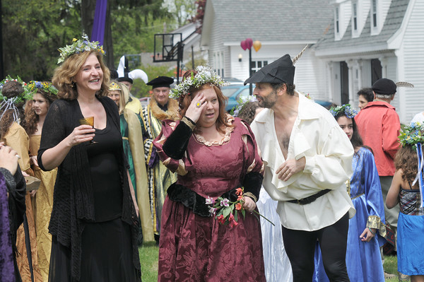 Newbury:Birthday girl  Kimm Wilkinson is overwhelmed as she walks with hosts Stephen Faria and Deidre Girard at a surprize Renaissance themed birthday party <br /> Sunday. jim vaiknoras/staff photo
