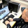 Newburyport: Officer Mathew Simons logs into eh new Newburyport Police Facebook page from the station Tuesday. Jim Vaiknoas/staff photo