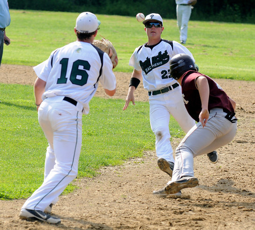 West Newbury: Pentucket's Jon Simard, #16 and John Cleary get a Whittier player in a rundown during their game at Pentucket Friday. Jim Vaiknoras/staff photo