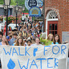 Newburyport: Student from the Merrimack Valley Charter School march down State Street Friday afternoon during their Walk for Water. The event, disigned to bring attention to the need for clean drinking water through out he world, led students from the school on Low Street up to the Mall then down to the river and back to the school. Jim Vaiknoras/staff photo