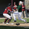 Newburyport: Pentucket's Connor McGuirk tries unsuccessfully to avoid the tag of Newburyport catcher james Conway during their game at Pettingill Park in Newburyport Monday. Jim Vaiknoras/staff photo