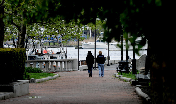 Newburyport: Two women walk down to the waterfront on a wet and grey Tuesday afternoon. Jim Vaiknoras/staff photo