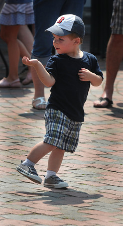 Newburyport: Kyer Perry, 2, of Woburn, plays air guitar to the music of Way to the River performs at the Spring Fest in Market Square in Newburyport Monday afternoon.The tow day event featured , crafts, food, childrens games, as well as entertainment. jim Vaiknoras/staff photo