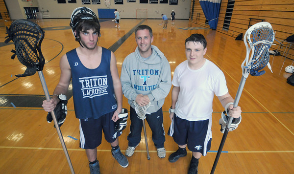 Byfield: Triton Lacrosse coach Sean Parsons stands between player Ryan Clark and C.J. Reusch at a rainy day practice in the Triton Gym. Jim Vaiknoras/staff photo
