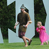 Newbury:Teddy Speck is chased by Mae Tollgren, 4, in front of giant letters spelling Lady Kimm's Party at a Renaissance themed birthday for Kimm Wilkinson at the Newbury home of Stephen Faria and Deidre Girard Sunday. jim vaiknoras/staff photo