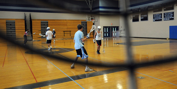 Byfield: The Triton High School  lacrosse team practices in the gym on a rainy Friday. JIm Vaiknoras/staff photo