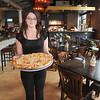 Newburyport: Employee Nicole White shows off a pizza fresh from the oven at Oregano's in Newburyport. They are participating in the Taste of Plum Island. JIm Vaiknoras/staff photo