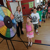 "Newburyport: Melissa LeBel of the Institution for Savings<br /> looks on as Nory Meinhart spins the Wheel of Savings at the Francis T. Bresnahan Elementary School Thursday. Representitives from the bank talked to students about saving money as part of the ""Teach Children to Save"" program. Jim Vaiknoras/staff photo"