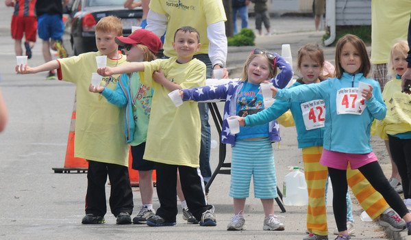 Newburyport: A line on kid volunteers hand out water to runners in The seventh annual Spring Fever 5K  on Merrimack Street Sunday. Jim Vaiknoras/staff photo